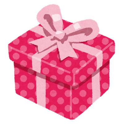 ピンクの水玉模様の包装紙と ...